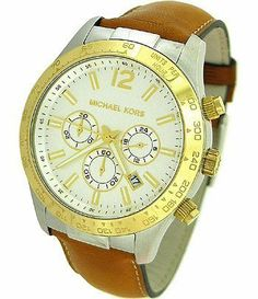 Men's Classic Watch with White Chronograph Dial Michael Kors. $199.95. Gold tone Round bezel.. Chronograph With Day, Date, and 3 Sub-Dials. White chronograph dial, gold tone numeral at twelve o'clock, stick indices. Case Size 45mm. Brown Leather Strap, Stainless Steel Case.