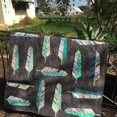 IG: shiraz_and_sewing // Selvage Quilt Entry //  for the Selvage Challenge 2016 hosted by Stash Builder Box. Made with various quilting cotton fabric selvages — www.selvagechallenge.com // www.stashbuilderbox.com. -- Just finished my #featherquilt and I love it I did this as part of the #selvagechallenge2016 and I used the feather pattern by #annamariehorner and its such a great pattern. The feathers are selveges on one side and #cottonandsteel on the other side. @selvagechallenge.