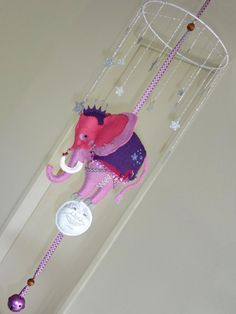"Elephant in the Sky nursery mobile by Lilliput Loft ""I asked my mother for fifty cents, to see the elephant jump the fence. He jumped so high, he touched the sky, and never came down did the fourth of July""."