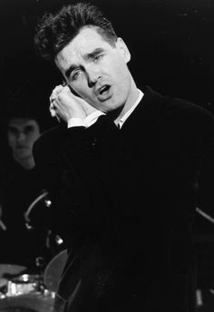 Morrissey and Mike Joyce (in the background): The Smiths on the Oxford Road Show, 1985.