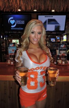 Big Breasted Blonde Hooters Girl With Two Beers