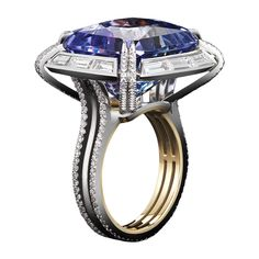 Cushion Cut Tanzanite Diamond Ring   From a unique collection of vintage cluster rings at https://www.1stdibs.com/jewelry/rings/cluster-rings/