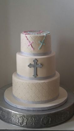 Communion cake for a boy and girl.