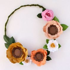 Carry a sweet paper floral wreath down the aisle instead of a bouquet