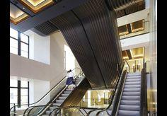 Bronze-clad escalators at Harrods, London