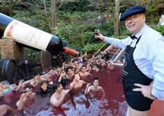Hakone Kowakien Yunessun Spa #Resort – Tokyo: Visitors are seen toasting with 2013 Beaujolais Nouveau wine in the wine spa at the Hakone Kowakien Yunessun Spa Resort close Tokyo. Notwithstanding a wine shower, the spa has a green tea shower (complete with a goliath tea pot) and an espresso drenching pool.