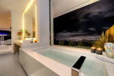 Gorgeous Views from the modern tub   Master bathroom at Carla Ridge in Beverly Hills By Boswell Construction #buildboswell
