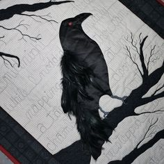 """Nevermore"", an original raven quilt with feathers by Brandie at abrandiecreation. 2011.  She quilted the poem in the background."