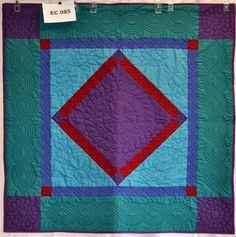 Amish Center Diamonds, quilts I saw similar to this in Shipshewanna, IN, had a luminescent quality due to color combinations.  Fantastic