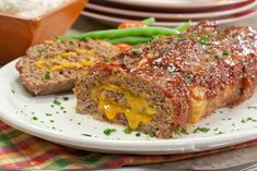 Anything stuffed with cheese is bound to be a hit, and that goes for our simply awesome Cheesy Stuffed Meatloaf. Our Test Kitchen really knocked themselves out to make this delicious novel meatloaf recipe look like you fussed; but only youll know wha Meatloaf Recipe With Cheese, Cheese Stuffed Meatloaf, Meatloaf Recipes, Cheesey Meatloaf, Best Meatloaf, Italian Meatloaf, Cheese Recipes, Meat Recipes, Cooking Recipes