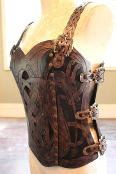 Leather armor corset, Viking design- celtic dragon cut-out design in heavy duty leather. Several sizes available! Leather Armor, Leather Tooling, Larp, Crea Cuir, Viking Costume, Viking Dress, Viking Armor, Viking Designs, Armadura Medieval