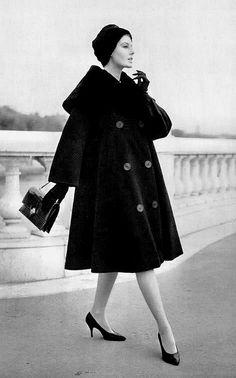 Coat by Jacques Griffe, bag Hermès, shoes Charles Jourdan. L'Officiel December 1958.