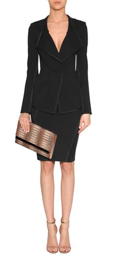 Donna Karan updates the classic black blazer with a sleek silhouette and modern detailing