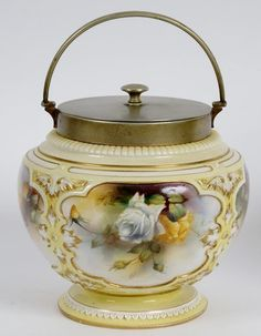 Biscuit Barrel -- A Royal Worcester Hadley Ware biscuit barrel with plated mounts, decorated roses, 21 cm high (over handle)