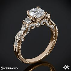 I didnt think i liked yellow gold, but this is simply STUNNING  This 3 Stone Engagement Ring is from the Verragio Insignia Collection.