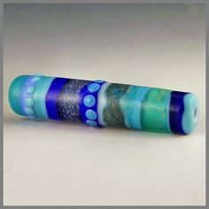 a long tubular focal with bands of blues by PolychromeBeads, $22.00