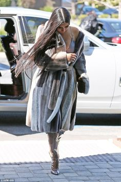Hot mama! Kim Kardashian didn't let the warm weather stop her from rocking a very extravag...