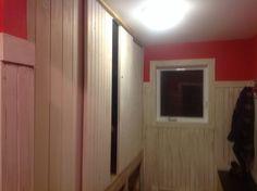 Mudroom sliding barn doors with builtin dog kennels below