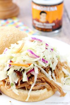 La Morena Chipotle Peppers in a Pulled Pork Sandwich with Mexican Style Coleslaw - BBQ with a Latin kick for summer! #VivaLaMorena