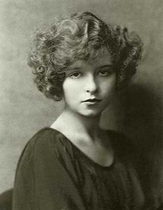 Short curly hair. Clara Bow