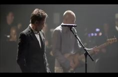 """Robert Downey Jr. sings """"Driven to Tears"""" with Sting."""