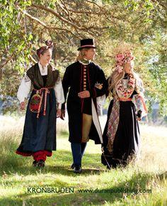 The traditional wedding costumes from Järvsö in Hälsningland, Sweden. Bridesmaid, Groom and Bride