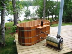 Hop into our Japanese deep soaking tub to give your body a relaxing experience. We offer cedar Ofuro hot tubs in both oval and round shapes. Japanese Soaking Tubs, Deep Soaking Tub, Deep Tub, Japanese Bathtub, Outdoor Tub, Outdoor Baths, Outdoor Showers, Outdoor Ideas, Spa Design