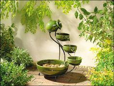 outdoor fountains 	outdoor fountains the features a lions hed athree desing.and this beautiful look and desing.	http://www.fountaincellar.com/