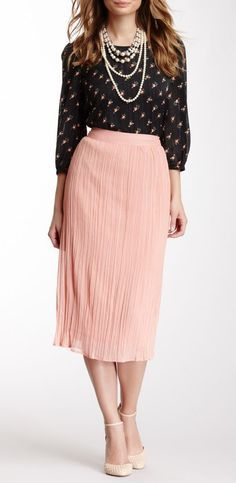 Blush skirt with black polka dot variations blouse.  Maybe  without the necklace.