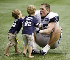 Jason Witten and his boys - too cute! I'm such a sucker for dotting football dads!
