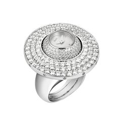 Secret ring watch with a rotating watchmaking module in white gold set with 443 diamonds. Piaget quartz movement 56P. Date: 2004