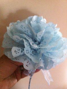 Dyed paper doily pom flower.