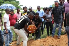 Burial service for 10-month-old Denize Angweta, who died of malaria, in a town outside of Luanda, Angola.