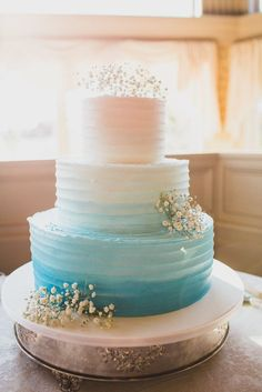 Ombre Blue and White Tiered Wedding Cake | Carlo's Bakery | MDS Floral Design | Mary + Roy Photography https://www.theknot.com/marketplace/mary-+-roy-jacksonville-fl-615188