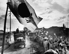 Civilians cheer the arrival of a U.S. cavalry division in Munsan, South Korea, in October 1950. (AP Photo/Max Desfor)