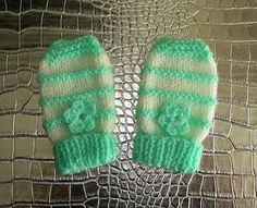 I really love these cute little baby mittens.  These are made for charity -but they would make a great little baby shower gift. T...