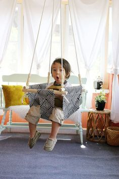 Most baby and toddler swings on the market are either plastic or expensive, and I knew I could easily make my own after eyeballing a few of the fabric and wood options I found online. This type of swi