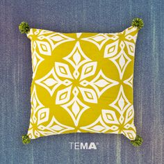 """Nothing cheers up a room more than pom poms on a pillow. This sophisticated pattern is subtly accented with festive tassels to add a little fun to your space. It comes in two different colors, each one deserving of a big """"woohoo!"""" and a room full of spirit fingers. #ThrowPillowThursday #TPT"""