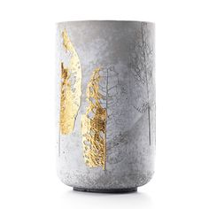 The design of this Concrete Vase plays with the contradiction between culture and nature. A bold geometrical shape is combined with the texture of organic ornaments, imprints of delicate foliage, some of them gold-plated. Natural grey concrete contrasts with genuine gold inlays. A very special object that can be appreciated by itself and of course be used as a vase for flowers or twigs.  By Doreen Westphal