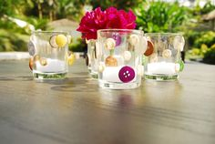 votives embellished with assorted buttons. Wedding Centerpieces, Accent Decor, Tablescapes, Buttons, Entertaining, Table Decorations, Floral, Home Decor, Decoration Home