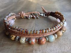 This beaded gemstone bracelet is made with, Impresion jasper beads, Rosequartz beads, Picture jasper beads, leather a metal lobster clasp ,a metal boho charm and metal beads. Table to convert from cm to inches. 15 cm = 5.90 inch 16 cm = 6.29 inch 17 cm = 6.69 inch 18 cm = 7.08 inch 19