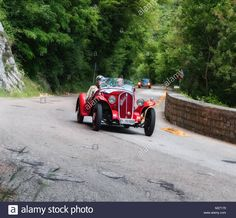 Download this stock image: GOLA DEL FURLO, ITALY - FIAT BALILLA SPAIDER on an old racing car in rally Mille Miglia 2017 the famous italian historical race (1927-1957) on May 19 - M27179 from Alamy's library of millions of high resolution stock photos, illustrations and vectors.