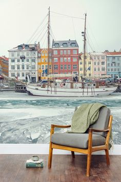 Enjoy the beautiful sights of Copenhagen from your living room with this city wallpaper design. Bright and wonderful buildings sit in between a frosty sea and sky, making a beautiful contrast. Perfect if you're after an European feel to your home.