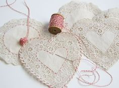 hand sewing on paper doilies