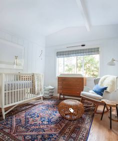 This warm ruggy nursery hits all the right notes! From the white walls & crib, to the wood accents, to the amazing area rug, this modern nursery design is spot on!