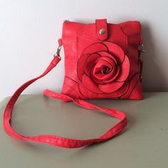 "Adorable Red Rose Crossbody Bag- NWOT NWOT. Non-Leather Red Shell. Gray Lining. Silver Hardware. Zip Closure. Exterior has a Snap Pocket on the Front (Great for Cell a Phone, Fits up to iPhone 6s). Interior has 1 Slip Pocket. Removable Strap. Measures 7""Hx7""L and Adjustable Drop Length 11""- 21""  ✅REASONABLE OFFERS NO TRADES NO PAYPAL Bags Crossbody Bags"