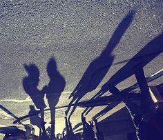 Group pf people with shadows by Faisal Almalki