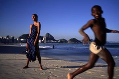 David Alan Harvey, New York Times Fashion Shoot, 2000, Rio De Janerio, Brazil. The woman is age between 25 to 44 years old and the boy is age between 13 to 18 years old. This photograph was taken for New York Times Fashion magazine shoot 2000 in Rio De Jarneiro, Brazil. This photograph has nice blends of blues and mixes well with the light, the teenage boy is on 3rd vertical line and woman is on the 1st vertical line