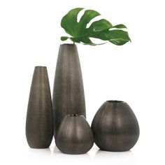 Rialto Bronze Textured electroplated porcelain vases. See in store for price and details! www.lambertpaint.com