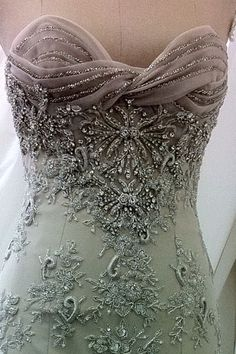 I love the top of this dress, and I am not usually big on beading.. But this is beautiful.
